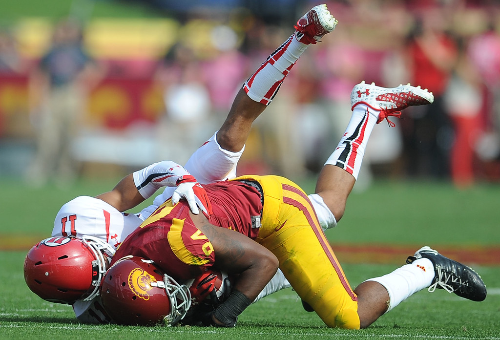 . Southern California wide receiver Darreus Rogers (84) catches a pass for a first down over Utah defensive back Davion Orphey (11) during the first half of an NCAA college football game in the Los Angeles Memorial Coliseum in Los Angeles, on Saturday, Oct. 26, 2013.  (Photo by Keith Birmingham/Pasadena Star-News)