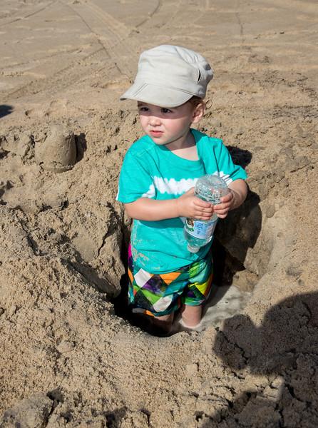 Caleb in a hole on the beach.jpg
