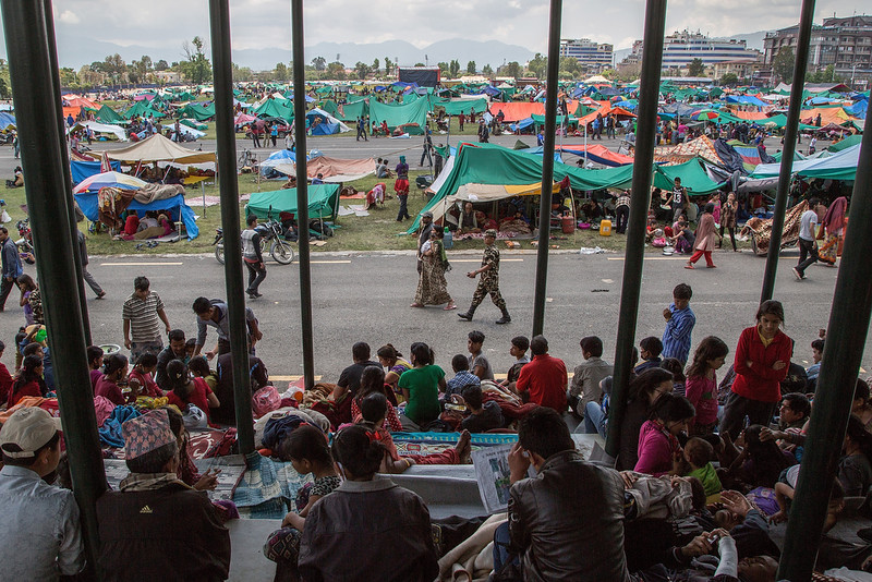. Thousands of residents take shelter in an evacuation area set up by the authorities in Tundhikel park on April 27, 2015 in Kathmandu, Nepal. A major 7.8 earthquake hit Kathmandu mid-day on Saturday, and was followed by multiple aftershocks that triggered avalanches on Mt. Everest that buried mountain climbers in their base camps. Many houses, buildings and temples in the capital were destroyed during the earthquake, leaving over 3000 dead and many more trapped under the debris as emergency rescue workers attempt to clear debris and find survivors.  (Photo by Omar Havana/Getty Images)