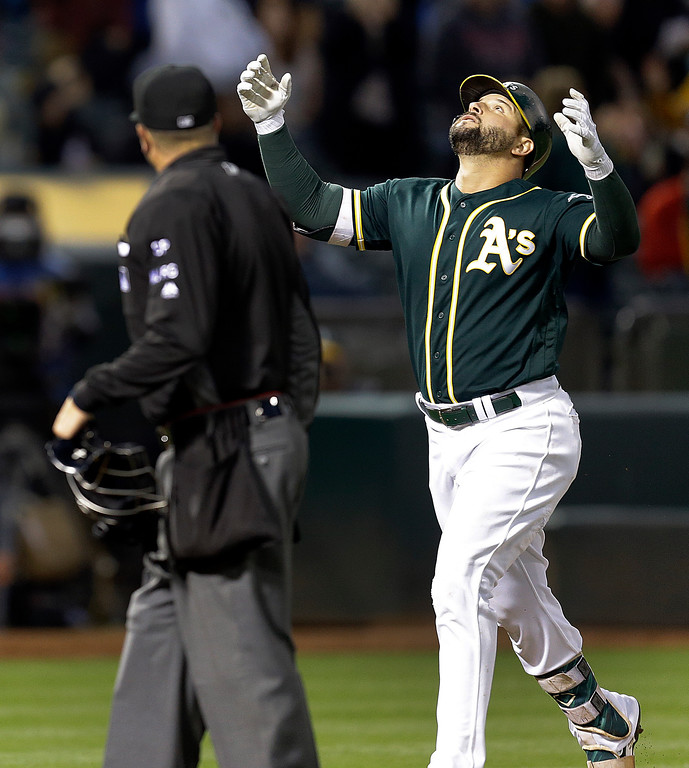 . Oakland Athletics\' Yonder Alonso celebrates after hitting a home run off Cleveland Indians\' Carlos Carrasco during the fifth inning of a baseball game Friday, July 14, 2017, in Oakland, Calif. (AP Photo/Ben Margot)