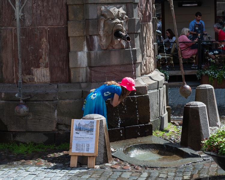 A drink of water from the fountain at Stortorget, Gamla Stan, Stockholm, Sweden