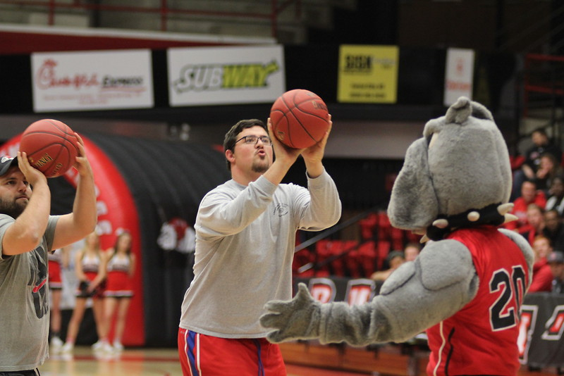Students Micah Honeycutt and James Mauney compete in free throw competition during timeout.