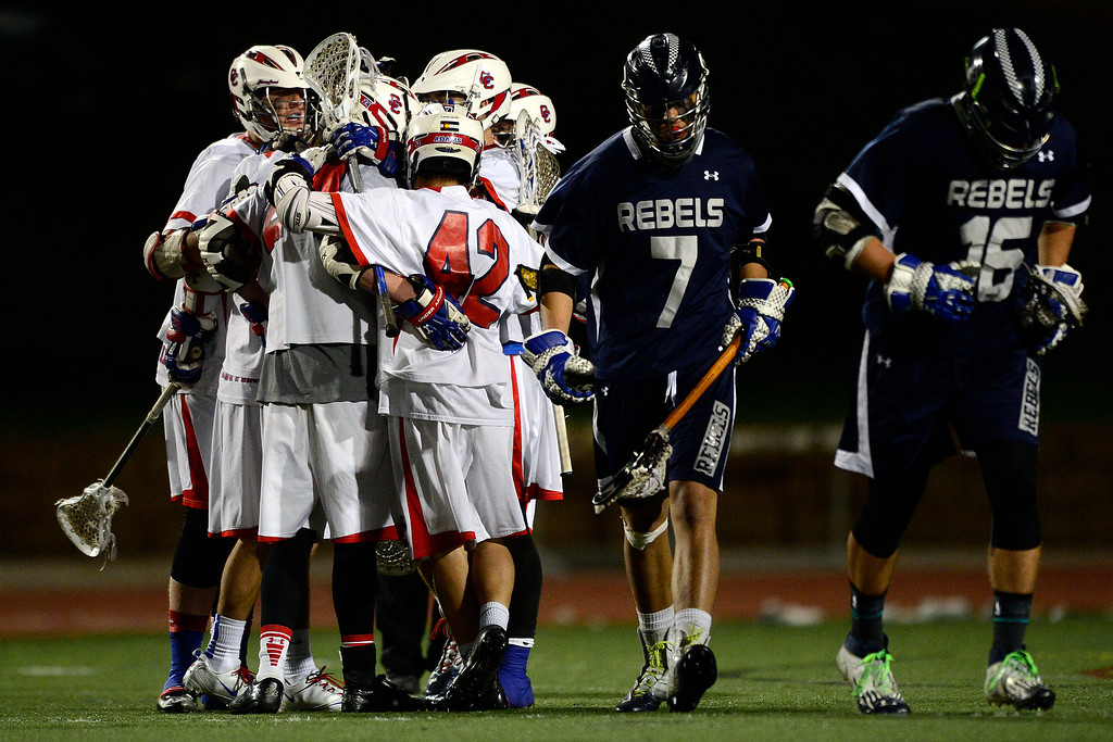 . Cherry Creek celebrates a goal against Columbine during Cherry Creek\'s 7-6 win.  (Photo by AAron Ontiveroz/The Denver Post)