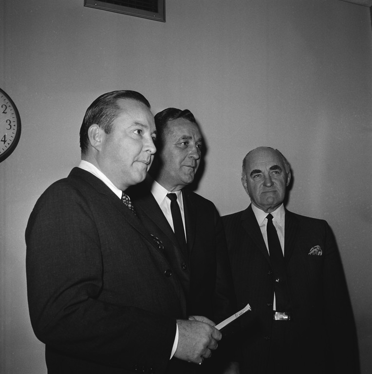 . Detroit Lions President William Clay Ford, left, announces that head coach George Wilson, center, had been given an extended coaching contract for an indefinite period, Dec. 21, 1964. Lions\' general manager Edwin Anderson is at right. At the same time, Ford revealed that joint decision was made by the three, relieving all the Lions assistant coaches of their duties, with Wilson free to form his new staff for the 1965 season. (AP Photo/Alvan Quinn)
