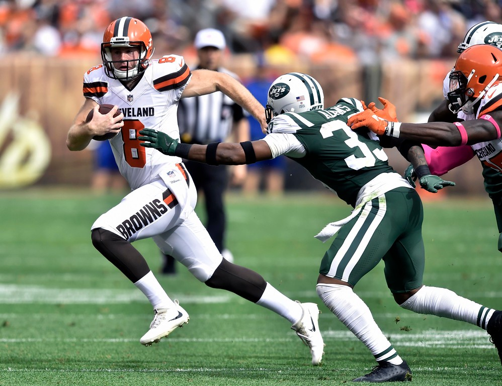 . Cleveland Browns quarterback Kevin Hogan (8) scrambles against New York Jets strong safety Jamal Adams (33) during the second half of an NFL football game, Sunday, Oct. 8, 2017, in Cleveland. (AP Photo/David Richard)