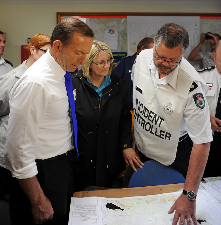 . Australian Prime Minister Tony Abbott (L) receives a bush fire briefing at Winmalee Fire Station in Sydney\'s Blue Mountains on October 18, 2013.  AFP PHOTO / Greg WOOD/AFP/Getty Images