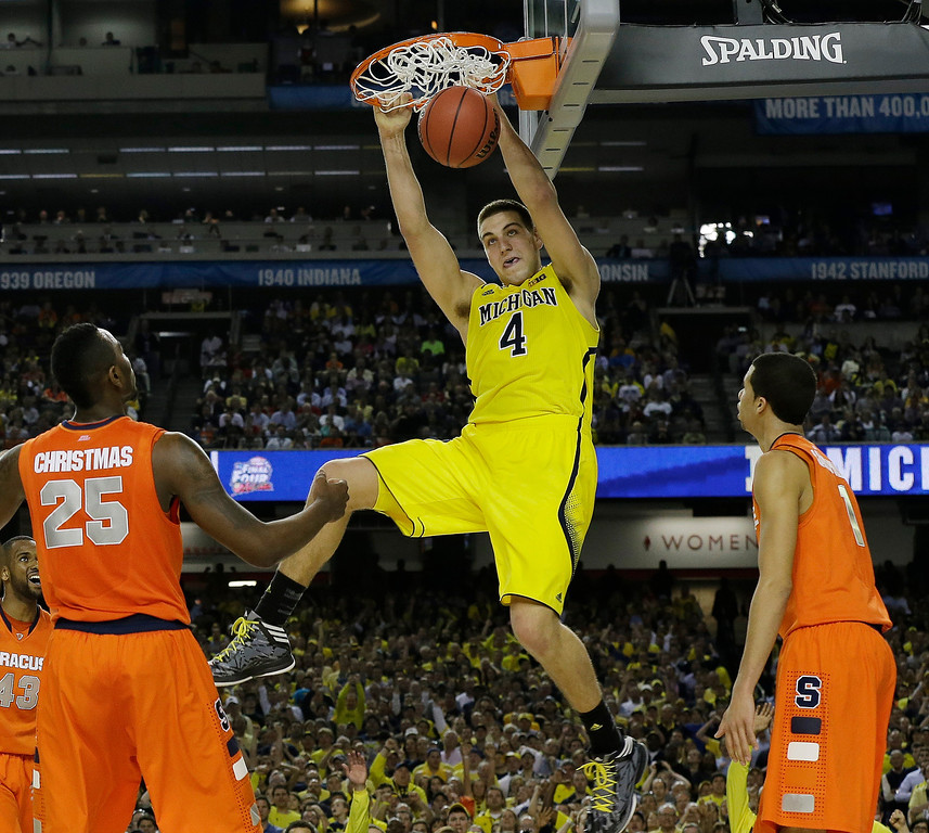 . Michigan\'s Mitch McGary dunks the ball against Syracuse during the second half of the NCAA Final Four tournament college basketball semifinal game Saturday, April 6, 2013, in Atlanta. (AP Photo/Charlie Neibergall)