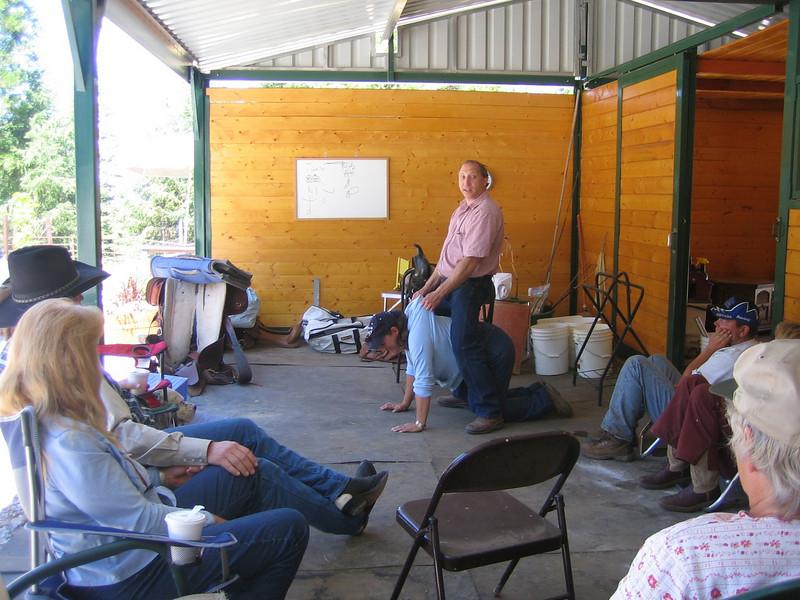David demonstrating how to ride janeta seat - Karen is playing horse