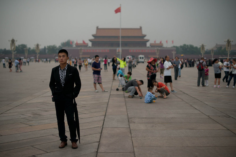 . A plain-clothes policeman (L) follows suspected journalists on Tiananmen square in Beijing on June 4, 2013. Authorities launch a major push every June 4 to prevent discussion of the violently crushed 1989 pro-democracy protests, in which at least hundreds of people died.  Ed Jones/AFP/Getty Images