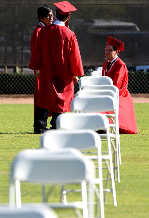 . Students take a moment prior to the Whittier High School graduation at Whittier College in Whittier, Calif., on Wednesday, June 4, 2014.  (Keith Birmingham/Pasadena Star-News)