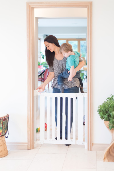 Fred_Stairgates_Screw_Fit_Wooden_Gate_Lifestyle_white_mum_baby_in_arm.jpg