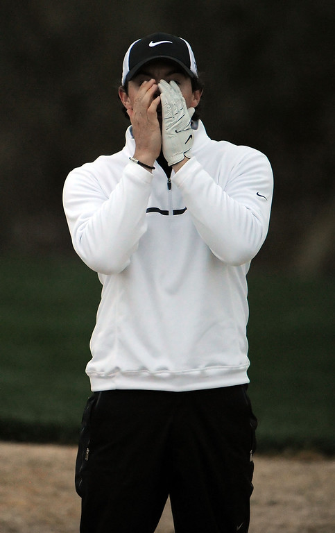 . MARANA, AZ - FEBRUARY 21:  Rory McIlroy of Northern Ireland reacts after his bunker shot on the 18th hole during his match with Shane Lowry of Ireland during the first round of the World Golf Championships - Accenture Match Play at the Golf Club at Dove Mountain on February 21, 2013 in Marana, Arizona. Round one play was suspended on February 20 due to inclimate weather and is scheduled to be continued today. Lowry won 1 up in 18 holes.  (Photo by Stuart Franklin/Getty Images)