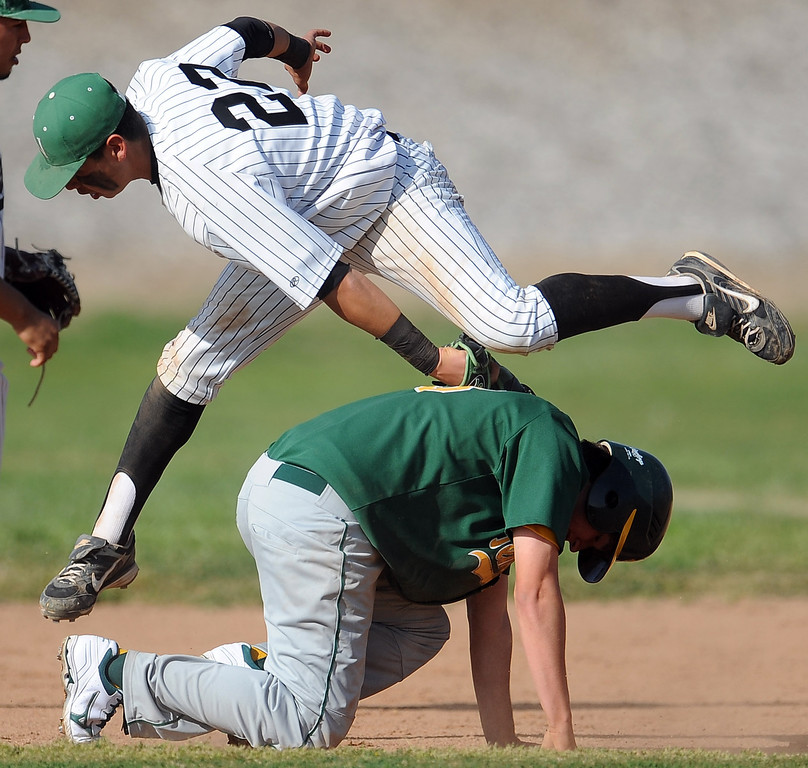 . Nogales first baseman Anthony Giordado (22) tags out Temple City\'s Gabriel Juarez in a run down between first and third in the fourth inning of a prep baseball game at Nogales High School on Tuesday, March 12, 2013 in West Covina, Calif. Nogales won 2-0.  (Keith Birmingham Pasadena Star-News)