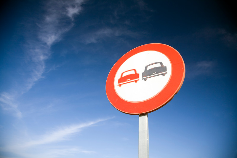 No passing traffic sign in front of a deep blue sky, Spain