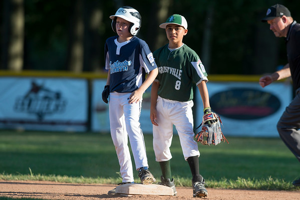 07/08/19 Wesley Bunnell | Staff Forrestville vs Southington North Little League baseball at Recreation Park in Southington on Monday July 8, 2019. Southington's Christian Hewko (21) stands safely on second base as short stop Hector Martinez (8) stands behind the base.