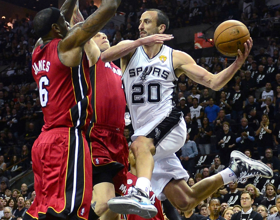 . Manu Ginobili (R) of the San Antonio Spurs looks to pass under pressure from LeBron James (L) and Chris Andersen of the Miami Heat during game three of the NBA Finals on June 11, 2013 in San Antonio, Texas.  FREDERIC J. BROWN/AFP/Getty Images