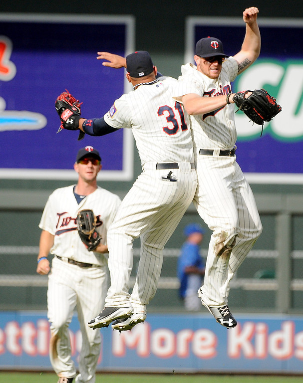 . Minnesota left fielder Oswaldo Arcia (31) and right fielder Chris Parmelee (27) celebrate the Twins\' 6-2 victory. (Pioneer Press: John Autey)