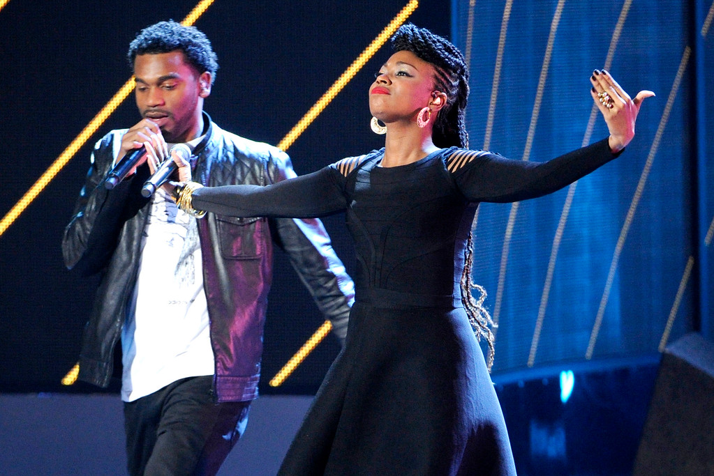 . Gloria Martinez, right, and Carlos Valencia, of the musical group ChocQuibTown, perform at the 15th annual Latin Grammy Awards at the MGM Grand Garden Arena on Thursday, Nov. 20, 2014, in Las Vegas. (Photo by Chris Pizzello/Invision/AP)