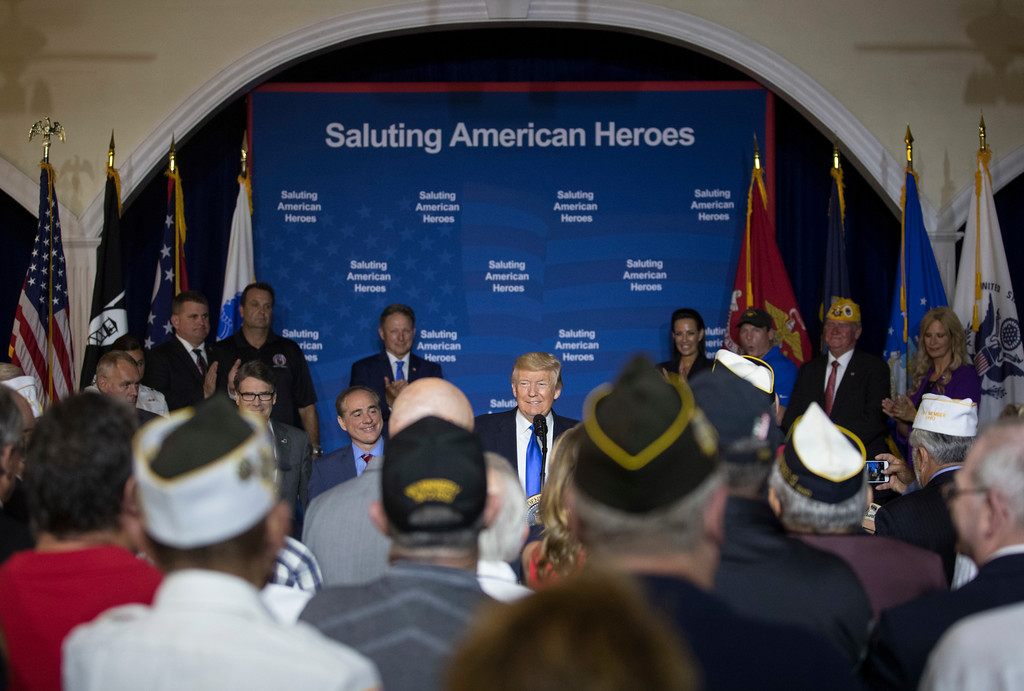 . President Donald Trump visits AMVETS Post 44, in Struthers, Ohio, Tuesday, July 25, 2017. (AP Photo/Carolyn Kaster)
