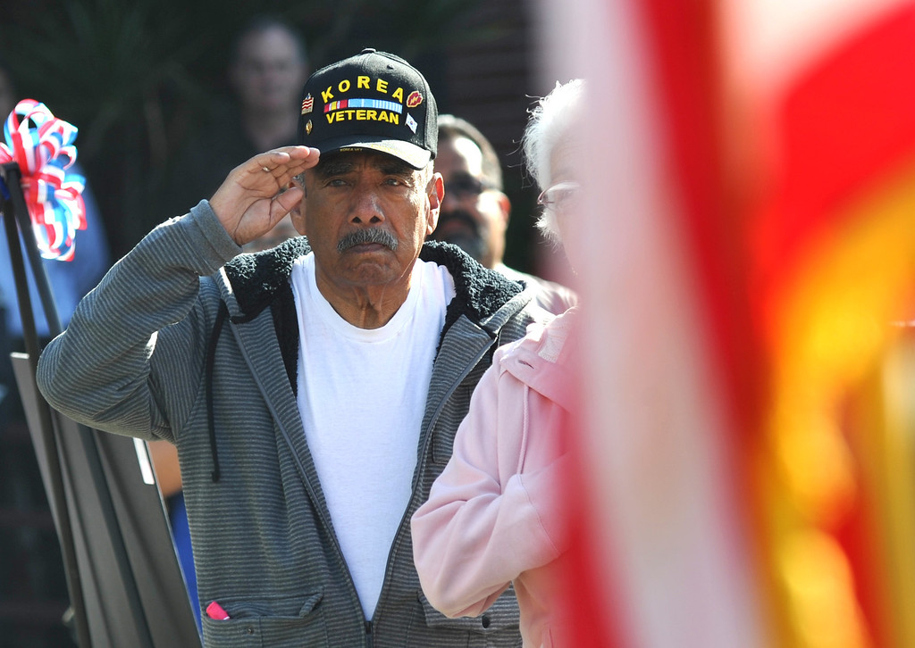 . Veterans salute as the national anthem is performed during the Veterans Day Celebration at El Monte City Hall on Monday November 11, 2013. Veterans are honored with speeches and music and a flag ceremony. (San Gabriel Valley Tribune/Staff Photo by Keith Durflinger)