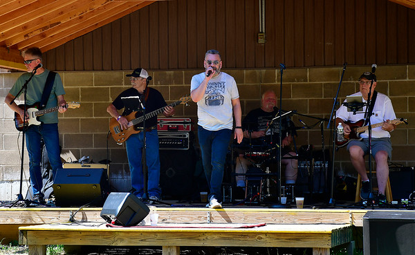 7/13/2019 Mike Orazzi | Staff Members of the band Unfinished Business perform during the 29th Annual Pork & Blues Pig Roast at the Swedish Club in Bristol on Saturday.