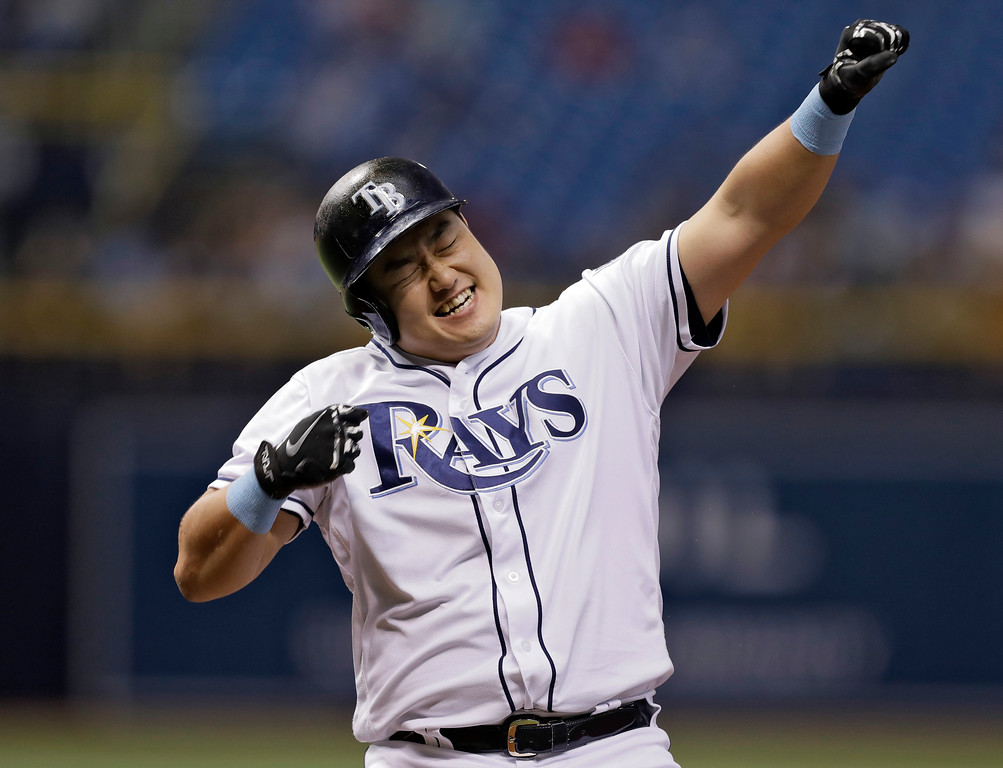 . Tampa Bay Rays\' Ji-Man Choi, of South Korea, reacts to the dugout after being hit by a pitch from Cleveland Indians pitcher Corey Kluber with the bases loaded during the second inning of a baseball game Monday, Sept. 10, 2018, in St. Petersburg, Fla. Rays\' Nicholas Ciuffo scored. (AP Photo/Chris O\'Meara)