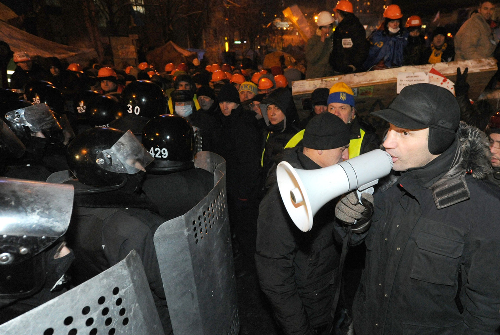. Leader of the Ukrainian opposition party UDAR (Punch) Vitali Klitschko speaks with a megaphone to anti-riot police on Independence Square in Kiev, on December 11, 2013. Ukrainian security forces pulled out of the epicentre of mass protests in Kiev today after a nine hour standoff with thousands of demonstrators, in a major boost for the opposition to President Viktor Yanukovych. VIKTOR DRACHEV/AFP/Getty Images