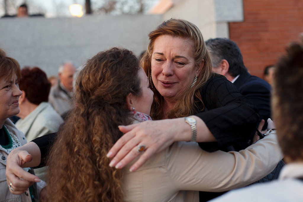 . MADRID, SPAIN - MARCH 11:  Pilar Manjon, president of the 11 March Victims of Terrorism Association hugs terrorism affected woman during a memorial for the victims of Madrid train bombings outside El Pozo train station during the 10th anniversary on March 11, 2014 in Madrid, Spain. The worst ever terrorist attack to happen in Spain killed 192 people and injured another 1,857, after devices exploded in four commuter trains heading to Atocha Railway Station in the early hours of March 11, 2004. Many of those affected are now suffering with financial problems. Former Spanish Prime Minister Jose Maria Aznar and his government supported that the attack was made by ETA but the judicial investigation dismounted this theory.  (Photo by Pablo Blazquez Dominguez/Getty Images)