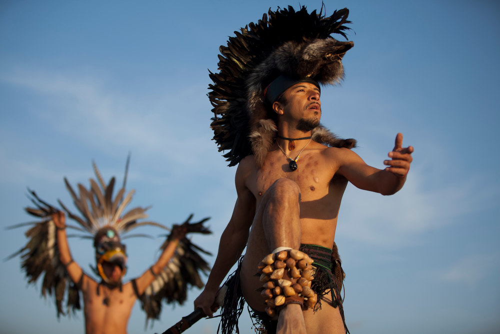 . Dancers perform as the sun rises at the Teotihuacan archeological site in Teotihuacan, Mexico, Friday, Dec. 21, 2012.  Many believe today is the conclusion of a vast, 5,125-year cycle in the Mayan calendar. Some have interpreted the prophetic moment as the end of the world, while others as believed it marked the birth of a new and better age. (AP Photo/Alexandre Meneghini)
