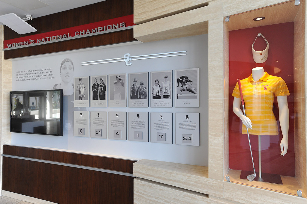 . A wall showcasing women\'s championships. Heritage Hall, which houses USC\'s athletic department, has been closed for the past year while undergoing a $35-million renovation.  The building first opened in 1971 at a cost of $2.8 million and was originally 48,000 square feet. It now is 80,000 square feet. As part of the renovation, Heritage Hall\'s two-story lobby has been transformed into a state-of-the-art museum space featuring interactive displays. Heritage Hall also includes a sports performance center, a broadcast studio, a lounge for Women of Troy student-athletes, a rowing ergometer room and an indoor golf driving area, plus new locker rooms, meeting rooms, equipment room and event space.   Los Angeles , CA. January 30, 2014 (Photo by John McCoy / Los Angeles Daily News)