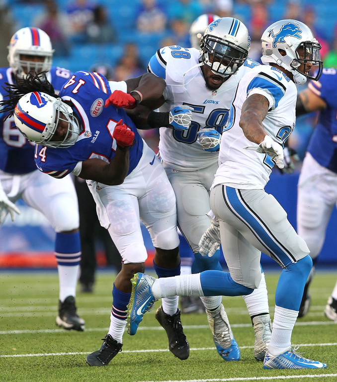 . Buffalo Bills wide receiver Sammy Watkins (14) is hit by Detroit Lions outside linebacker Ashlee Palmer (58) during the first half of a preseason NFL football game, Thursday, Aug. 28, 2014, in Orchard Park, N.Y. (AP Photo/Bill Wippert)