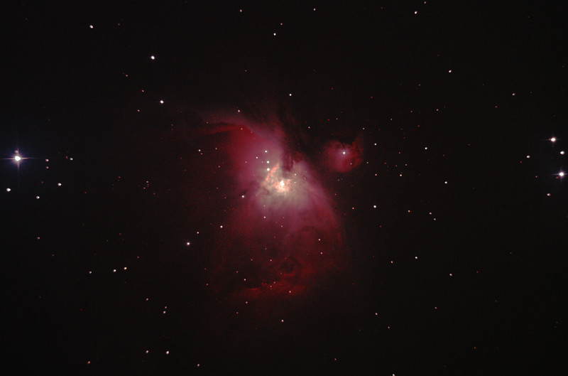 """Messier M42 NGC1976 Orion Nebula and NGC1977 Running Man Nebula - 14/04/2012 (Processed and cropped stack)  Prime focus of a borrowed 8"""" f/4 Newtonian. Cropped to show M42 only from the central portion of the image to minimise coma distortion. This was late in the year for M42 so it was low in my western skyglow and lacks detail and definition. Also see the uncropped version.   DeepSkyStacker 3.3.2 Stacked 85% of 6 Images ISO 800 120 Sec, 32 DARK, 0 BIAS, 0 FLATS, Post-processed by Photoshop CS5  Telescope - Bintel BT200 f/4.0 Newtonian with no Coma corrector (borrowed from Stephen Boyd), Hutech IDAS LPS-P2 filter, Canon 400D DSLR, Ambient 15C. Mount - Skywatcher NEQ6 Pro. Guidescope - Orion ShortTube 80 with Star Shoot Auto Guider."""