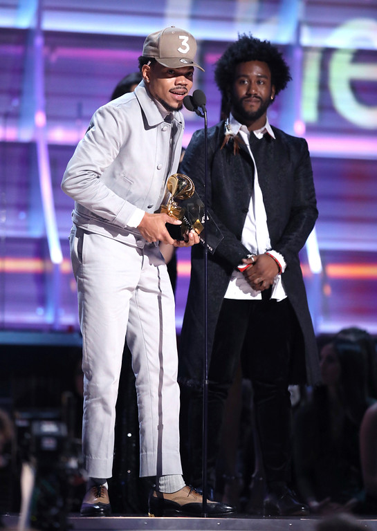 ". Chance The Rapper accepts the award for best rap album for ""Coloring Book\"" at the 59th annual Grammy Awards on Sunday, Feb. 12, 2017, in Los Angeles. (Photo by Matt Sayles/Invision/AP)"