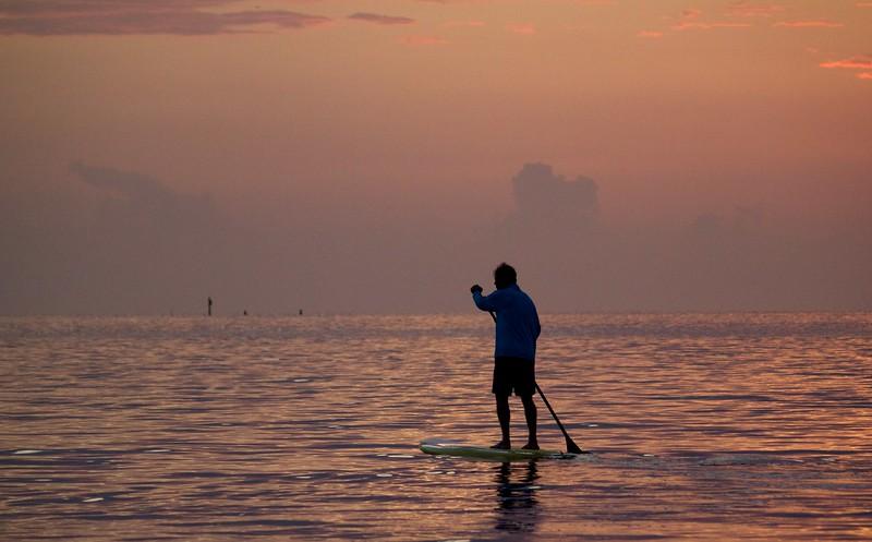 sunset paddleboarding