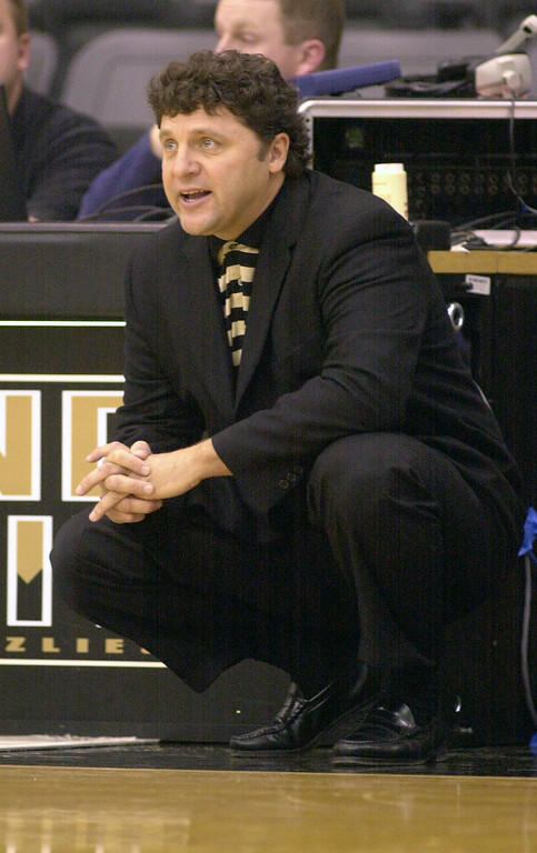 . Oakland University mens basketball head coach Greg Kampe gives orders to his team as they played the Premier All-Stars AAU, during first half action, Saturday, November 10, 2001, at the O\'rena in Rochester Hills, Mich.