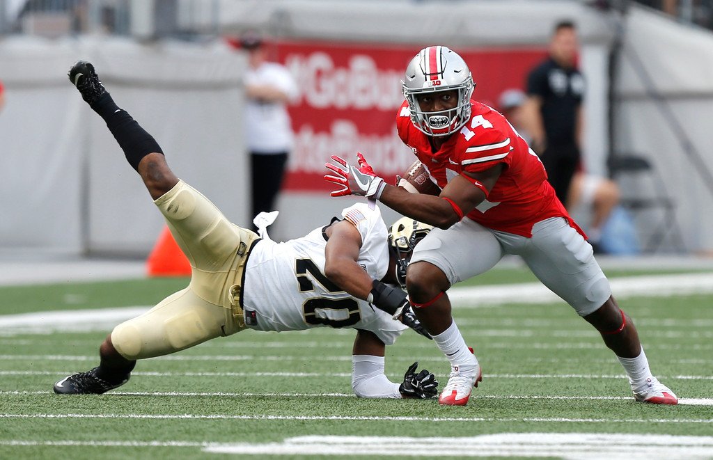 . Ohio State receiver K.J. Hill, right, escapes the grasp of Army defender Cameron Jones during the first half of an NCAA college football game Saturday, Sept. 16, 2017, in Columbus, Ohio. (AP Photo/Jay LaPrete)
