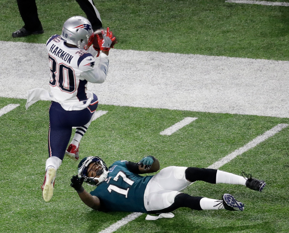 . New England Patriots strong safety Duron Harmon intercepts a pass intended for Philadelphia Eagles wide receiver Alshon Jeffery during the first half of the NFL Super Bowl 52 football game Sunday, Feb. 4, 2018, in Minneapolis. (AP Photo/Eric Gay)