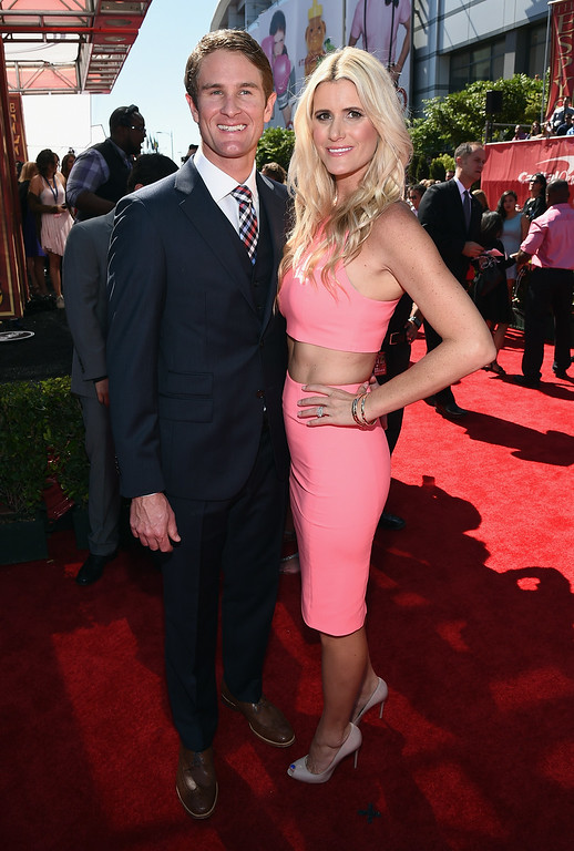 . LOS ANGELES, CA - JULY 16:  Race car driver Ryan Hunter-Reay (L) and model Beccy Gordon attend The 2014 ESPYS at Nokia Theatre L.A. Live on July 16, 2014 in Los Angeles, California.  (Photo by Michael Buckner/Getty Images For ESPYS)