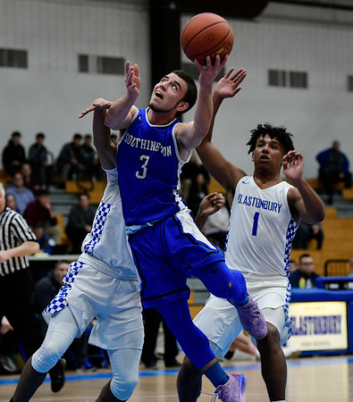 3/6/2019 Mike Orazzi | Staff Southington's Colin Burdette (3) during Wednesday night's Division II Second Round State Boys Basketball Tournament with at Glastonbury High School.