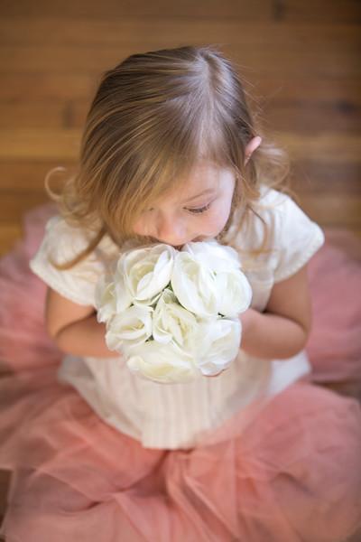 Ava Smelling Flowers.jpg