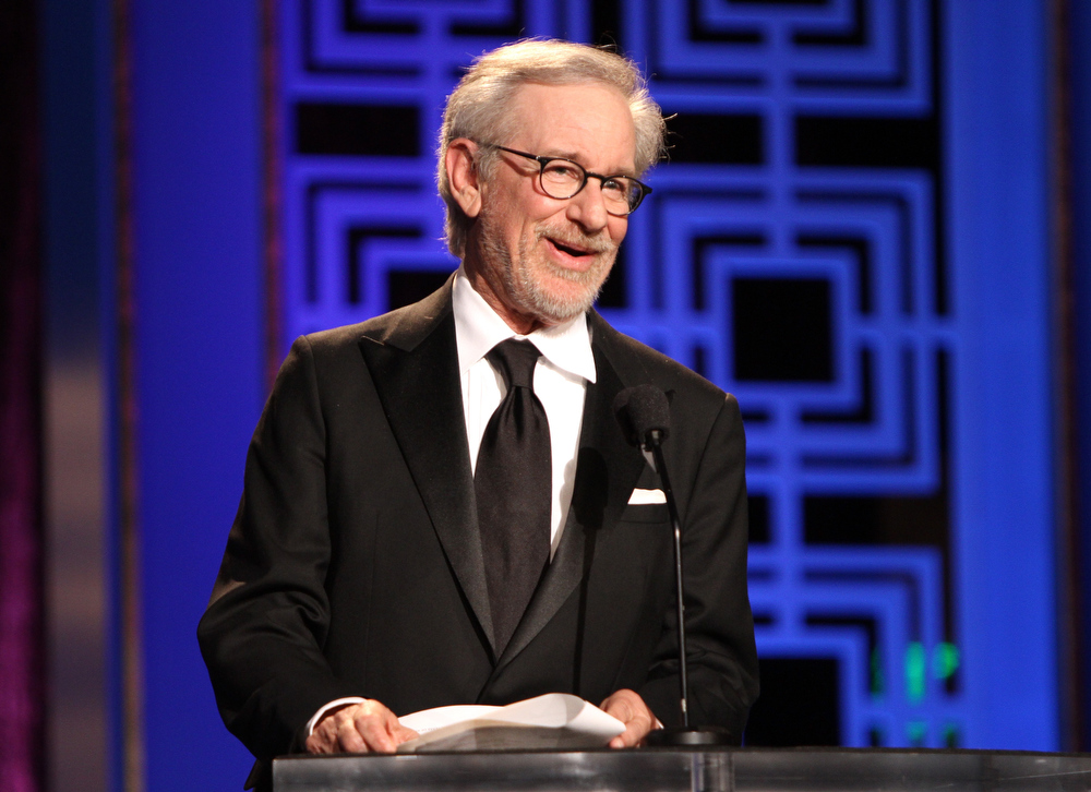 Description of . Filmmaker Steven Spielberg speaks onstage at the 2013 WGAw Writers Guild Awards at JW Marriott Los Angeles at L.A. LIVE on February 17, 2013 in Los Angeles, California.  (Photo by Maury Phillips/Getty Images for WGAw)
