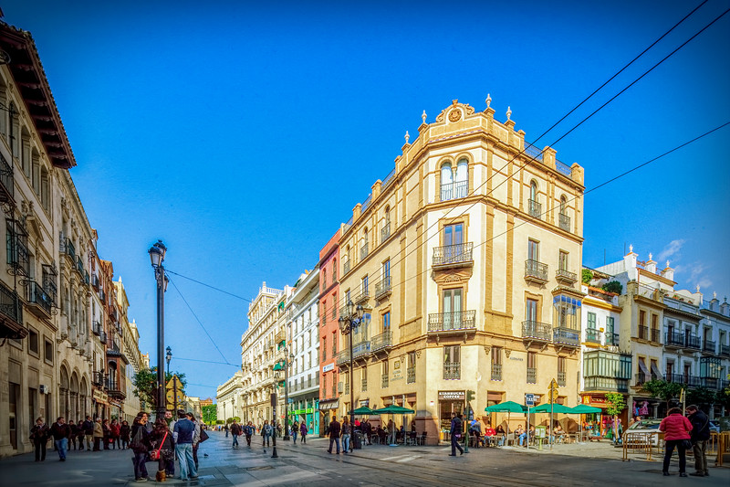 Avenida de la Constitucion (left) and Alemanes (right) street corner, Seville, Spain