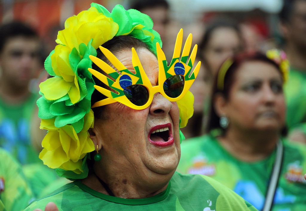 . A Brazilian supporter gestures during the 2014 FIFA World Cup Brazil vs Mexico match at the FIFA Fan Fest public viewing event in Rio de Janeiro, Brazil on June 17, 2014.    AFP PHOTO / TASSO  MARCELO/AFP/Getty Images