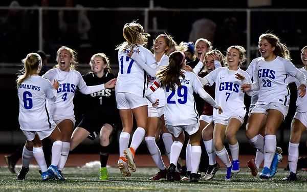 11/23/2019 Mike Orazzi | Staff Glastonbury High School celebrates a 1-0 win over Southington during the during the Class LL Girls State Soccer Tournament at Veterans Stadium in New Britain Saturday evening.