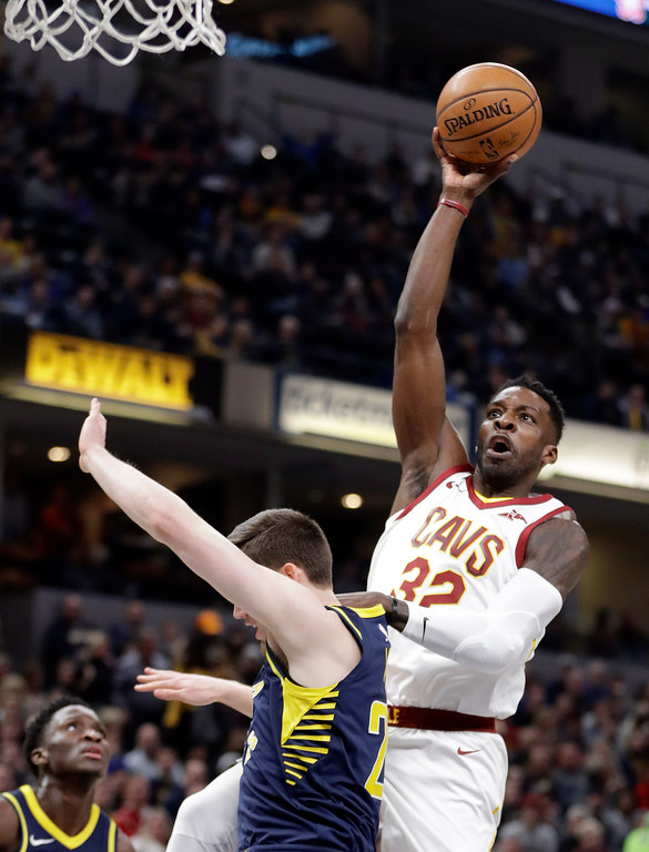 . Cleveland Cavaliers\' Jeff Green (32) shoots over Indiana Pacers\' T.J. Leaf during the first half of an NBA basketball game, Friday, Jan. 12, 2018, in Indianapolis. (AP Photo/Darron Cummings)