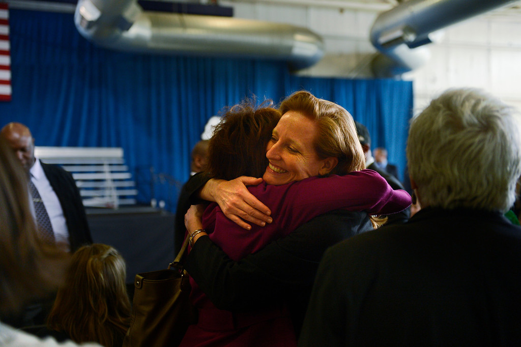 . DENVER, CO. - APRIL 03: Colorado State Rep Rhonda Fields is hugged by State Sen. Morgan Carroll when they meet before President Barack Obama speaks to uniformed officers and community leaders at the Denver Police Academy calling for Congress to act more like the state\'s Democratic-controlled legislature to pass stronger gun-control laws. (Photo By Joe Amon/The Denver Post)
