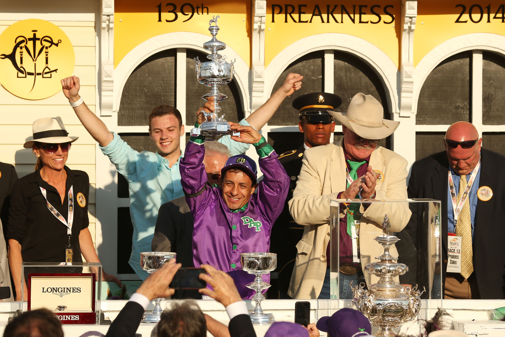 . Jockey Victor Espinoza celebrates with owner Steve Coburn and trainer Art Sherman after winning the 139th running of the Preakness Stakes atop California Chrome #3 at Pimlico Race Course on May 17, 2014 in Baltimore, Maryland.  (Photo by Matthew Stockman/Getty Images)