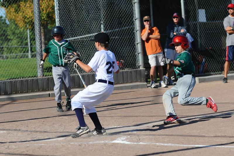 Mark Erbstoesser (at bat), Jordan Troy (sliding into home)