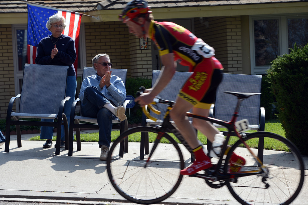 . Kathy and Frank Faxson watch as cyclist pass by their Redlands home Sunday April 7, 2013 during the Redlands Bicycle Classic. Crowds of spectators gather along the streets of Redlands for the final day of the 29th Annual Redlands Bicycle Classic. Rick Sforza/Staff photographer