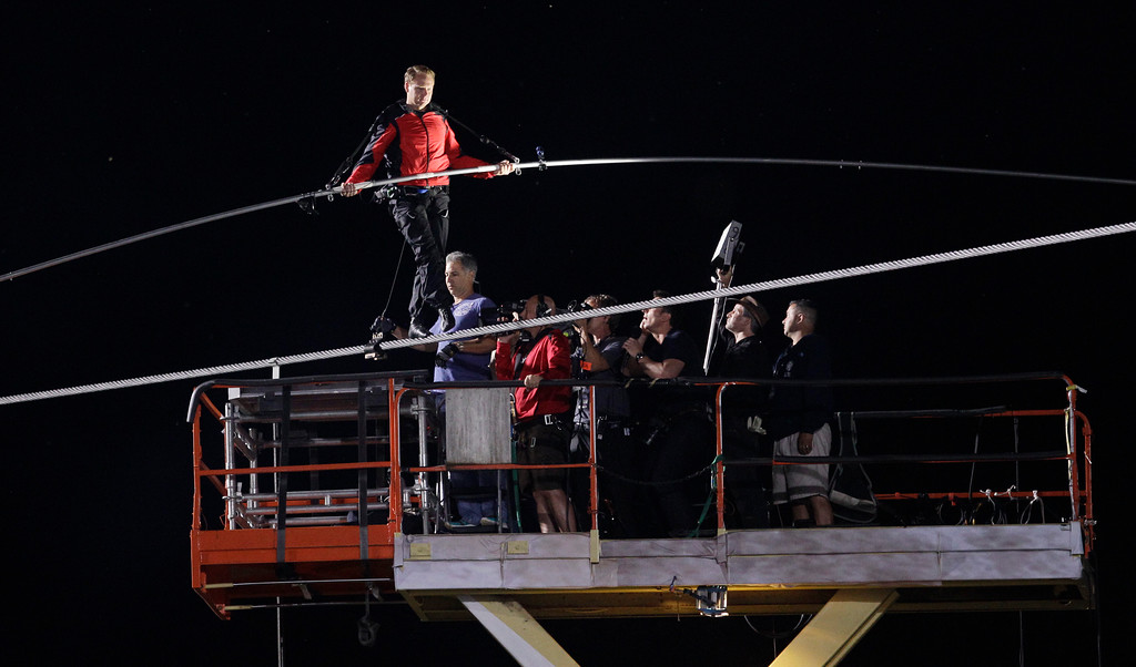 . Nik Wallenda begins his walk across Niagara Falls on a wire in Niagara Falls, N.Y., Friday, June 15, 2012. (AP Photo/David Duprey)